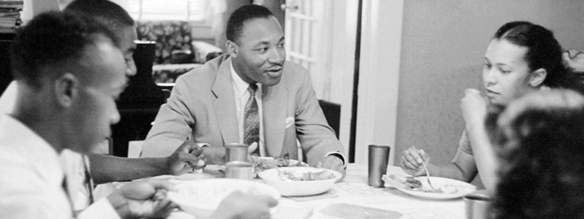Dr. Martin Luther King Jr at the dinner table at home.