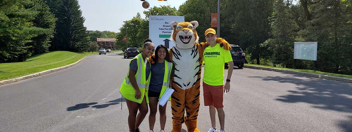 orientation leaders with coby tiger at college entrance