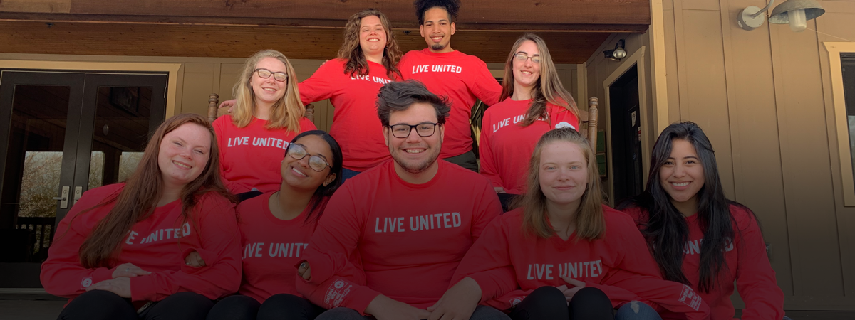"alternative spring break students in their group t-shirts saying ""live united"""