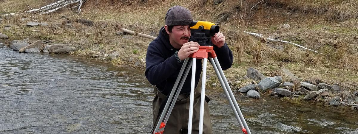 student conducting a stream survey