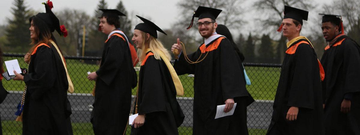 graduates walking to ceremony