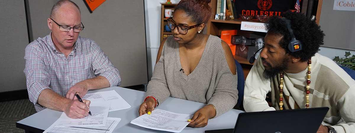 professor and students in tv studio