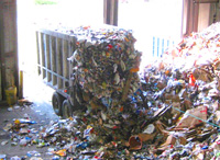 trash truck dumping waste at recycling facility
