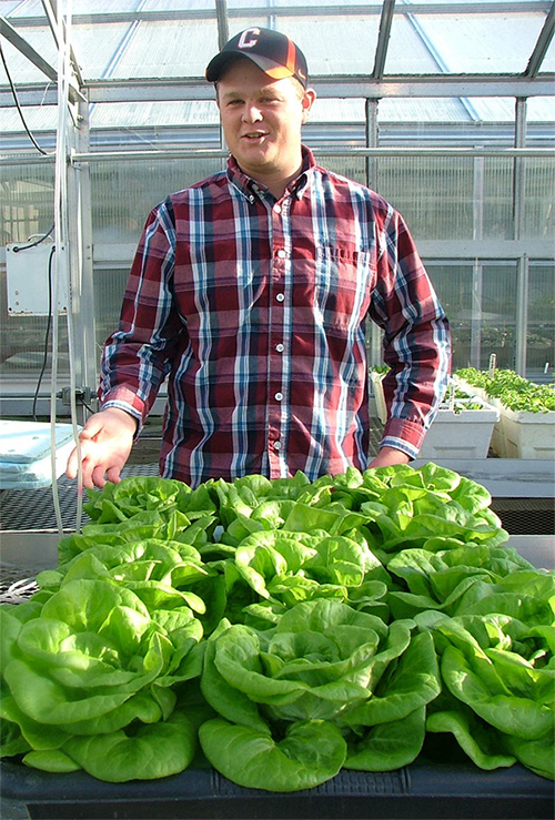 Plant Science student Samuel Nolan shows off his hydroponic lettuce experiment.