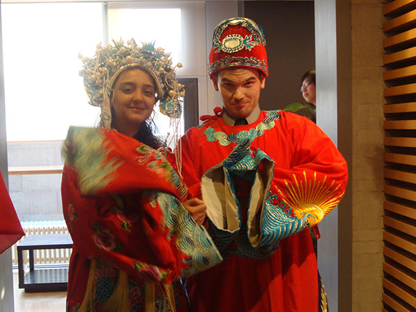 Students Lydia Hanany and Erich Keena sport traditional Chinese costumes during SUNY China trip.