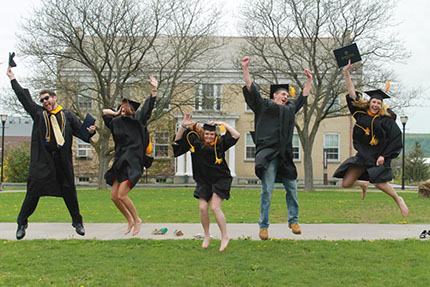 Graduates Jumping in the Air