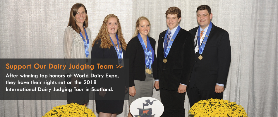 Members of the Dairy Judging Team pose with their coach along with their awards from World Dairy Expo