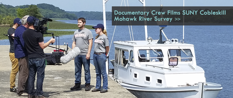 Documentary crew interviewing suny cobleskill students on mohawk river