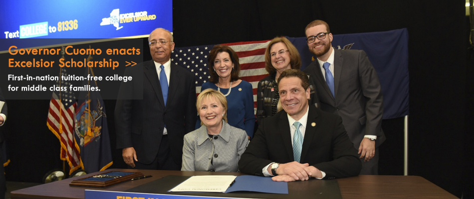 Photo of Governor Cuomo signing legislation for Excelsior Scholarship Program courtey of the Governor's Office