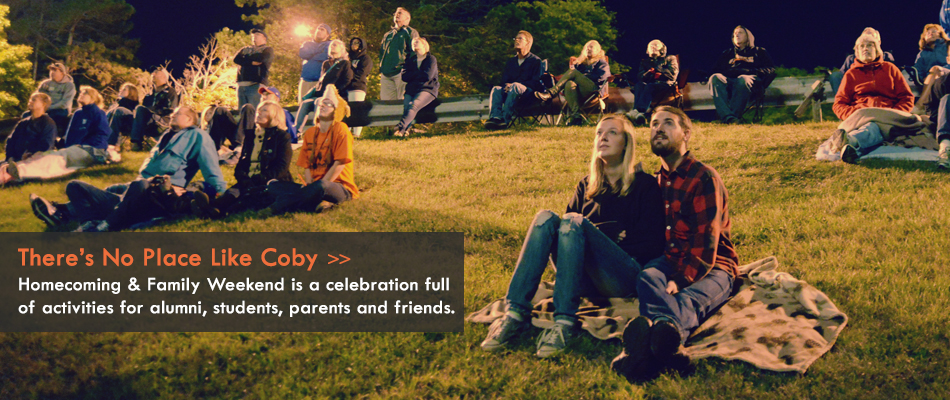 families sit on the hill to watch fireworks during Homecoming weekend