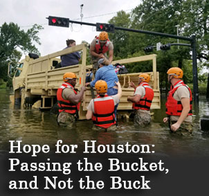 The Coast Guard assists a woman into a convey as waist-high water flows in Texas.